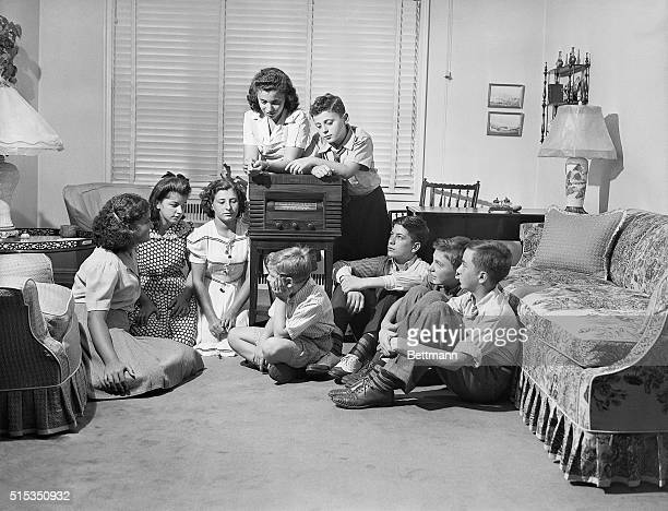Betty Jean and Henry Schwaber 13 and 10 respectively are shown surrounded by their friends at their Jamaica Long Island home listening to President...