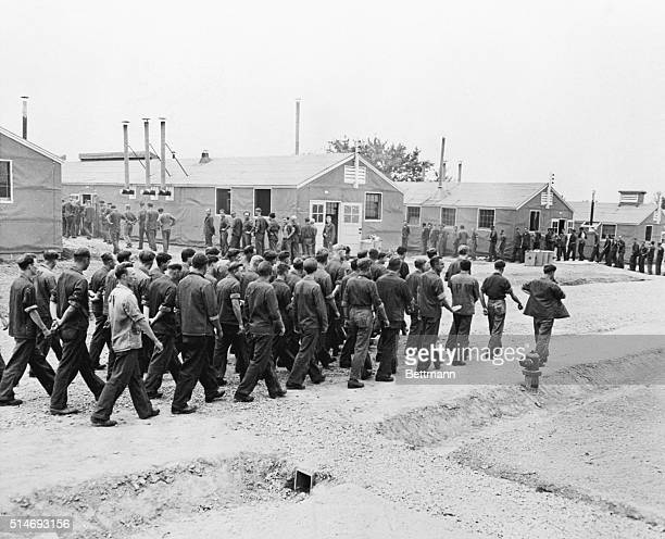 1943Camp Beckinridge KY Some of the 2000 German prisoners of war housed at Camp Beckinridge are shown marching to the mess hall at mealtime German...