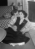1950Brentwood CA THE HILTONS 'AT HOME' After a tenhour long day of running the hotel Nick Hilton relaxes with his movie star wife at their temporary...
