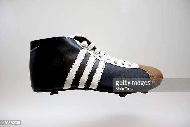 A 1950era cleat is displayed in the Museum of Football on June 10 2014 in Sao Paulo Brazil The museum is housed inside the famed Pacaembu Stadium and...