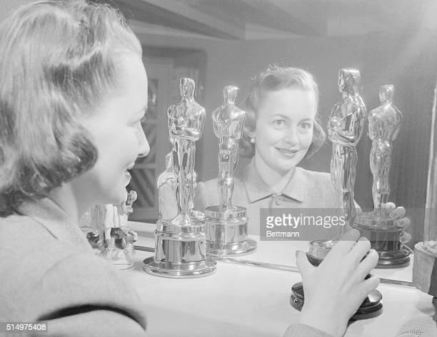 Portrait of Actress Olivia De Haviland and the OScars that she has won