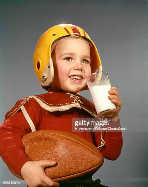 1950s 1960s BOY DRINKING...