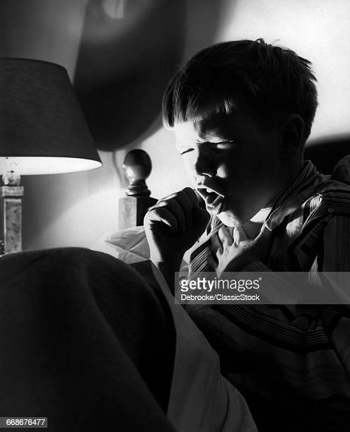 1950s 1960s BOY IN BED AT...