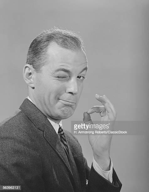 1950s 1960s MAN WINKING...
