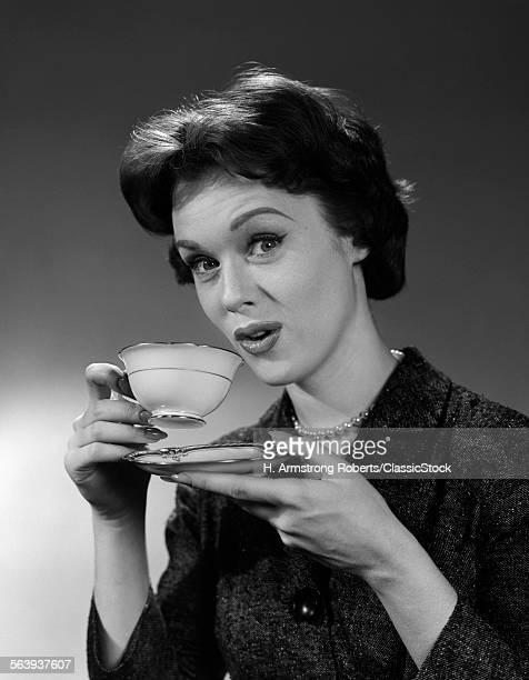 1950s 1960sWOMAN HOLDING...