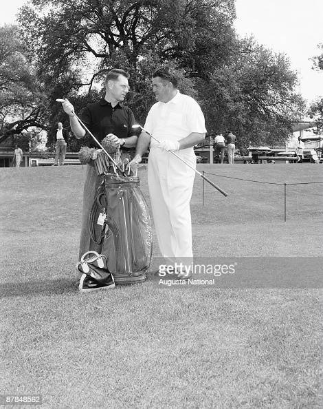A golfer and Ed 'Porky' Oliver pick out clubs during a 1950s Masters Tournament at Augusta National Golf Club in April in Augusta Georgia