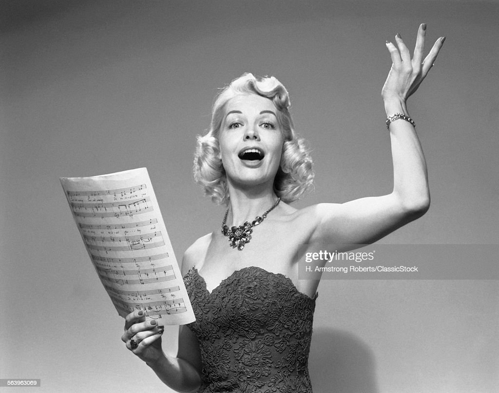 1950s BLOND WOMAN SINGING...