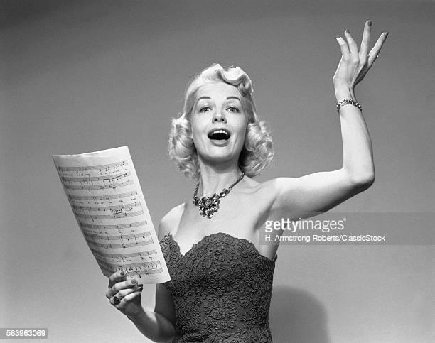 1950s BLOND WOMAN SINGING...