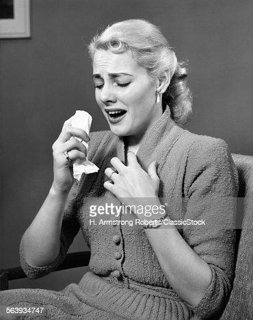 1950s BLOND WOMAN SNEEZING...