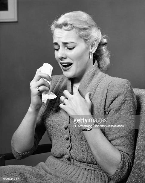 1950s BLOND WOMAN SNEEZING...