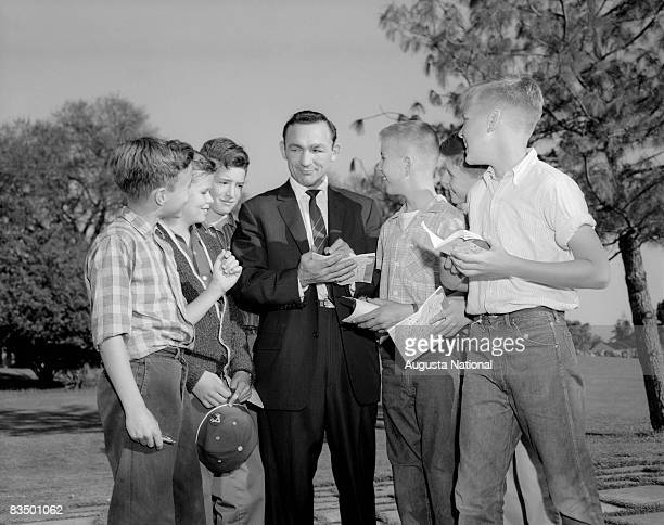 Boxer Carmen Basilio and some autograph seekers during a 1950s Masters Tournament at Augusta National Golf Club in Augusta Georgia
