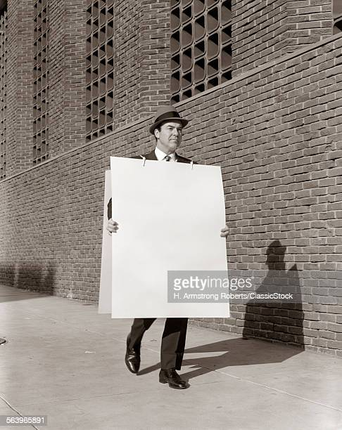 1950s BUSINESSMAN WALKING...