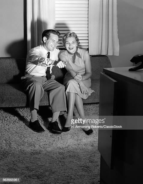 1950s COUPLE IN DARKENED...