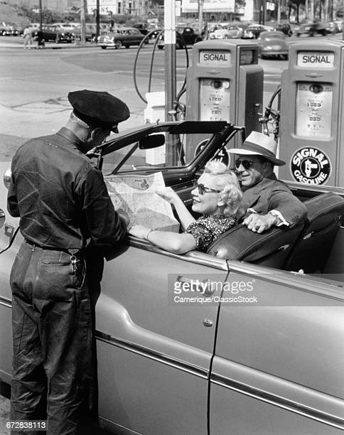 1950s COUPLE WITH MAP IN...