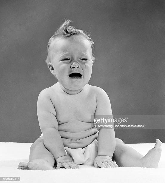 1950s CRYING BABY SEATED...