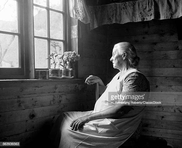 1950s ELDERLY WOMAN SEATED...