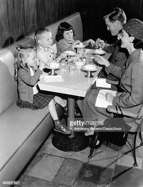 1950s FAMILY EATING ICE...