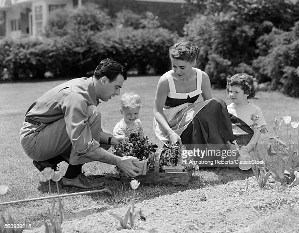 1950s FAMILY IN GARDEN...
