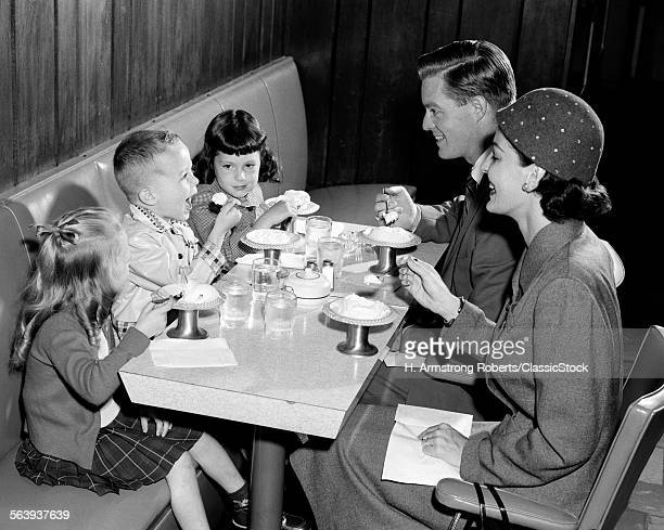 1950s FAMILY OF 5 EATING...