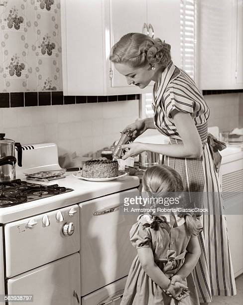 1950s HOUSEWIFE IN KITCHEN...