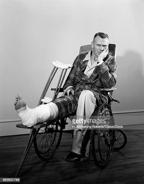 1950s MAN IN WHEELCHAIR...
