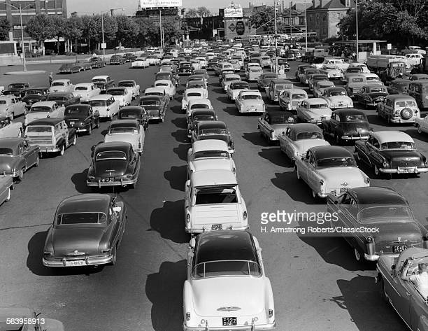 1950s MANY CARS IN TRAFFIC...