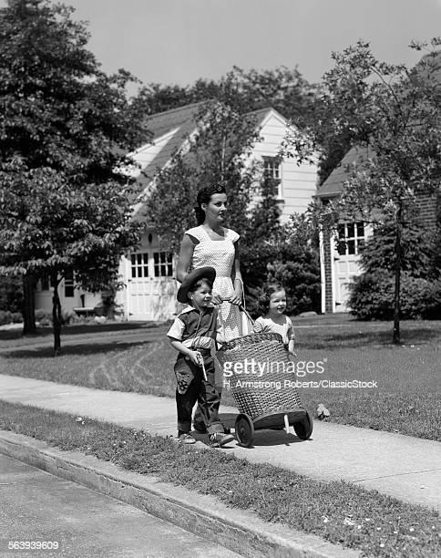 1950s MOM ON SIDEWALK...