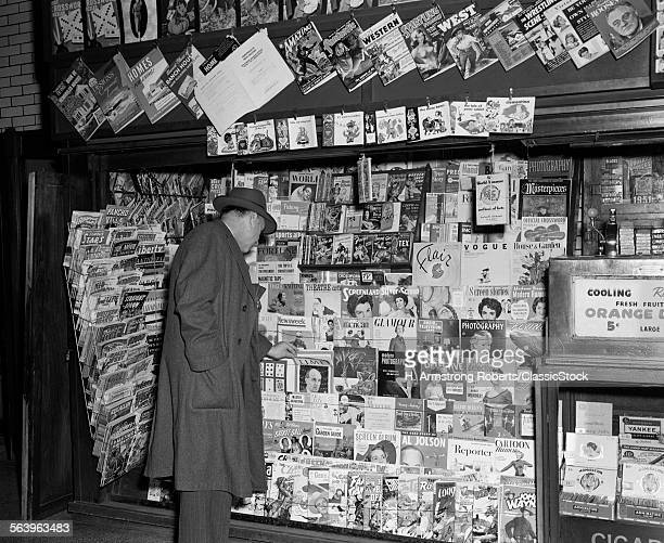 1950s NEWSSTAND WITH MAN...