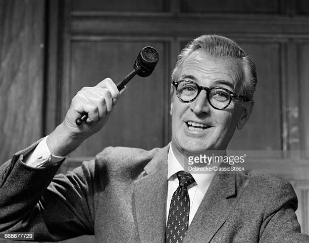 1950s SMILING MAN JUDGE IN...