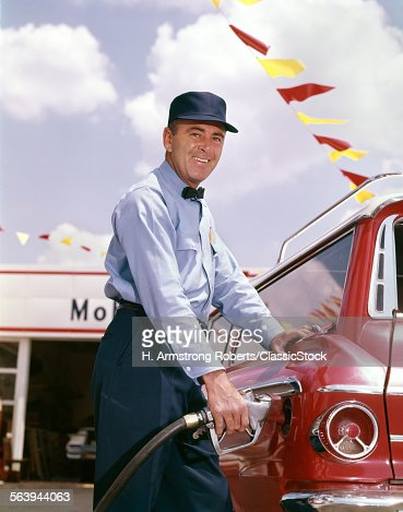 1950s SMILING UNIFORMED...