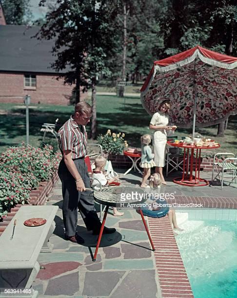 1950s SUBURBAN FAMILY IN...