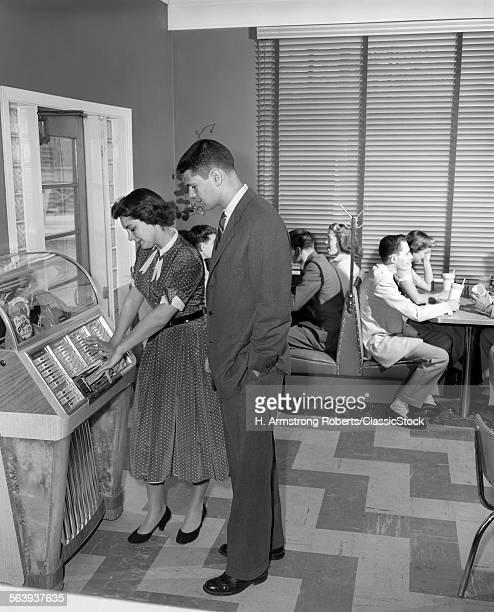 1950s TEEN COUPLE PLAYING...