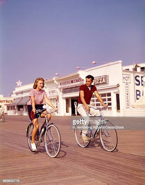 1950s TEEN COUPLE RIDING...