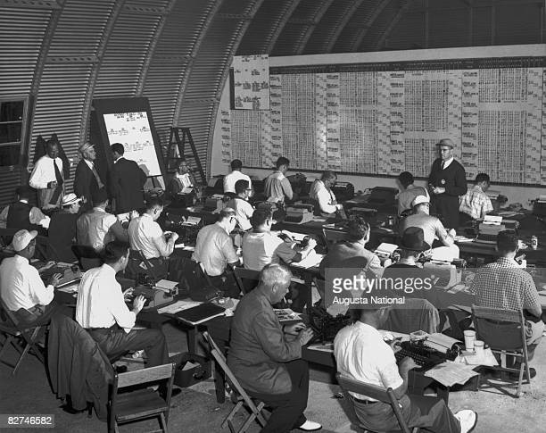 The media work from the press quonset hut during the Masters Tournament at Augusta National Golf Club during the 1950s and 1960s in Augusta Georgia