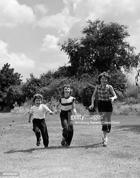 1950s THREE GIRLS RUNNING...
