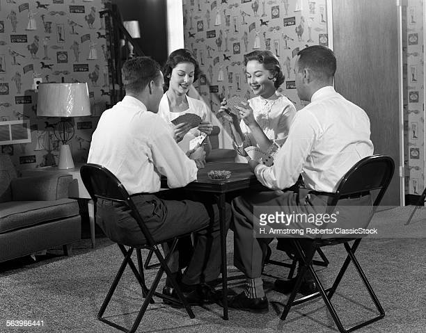 1950s TWO COUPLES SEATED...
