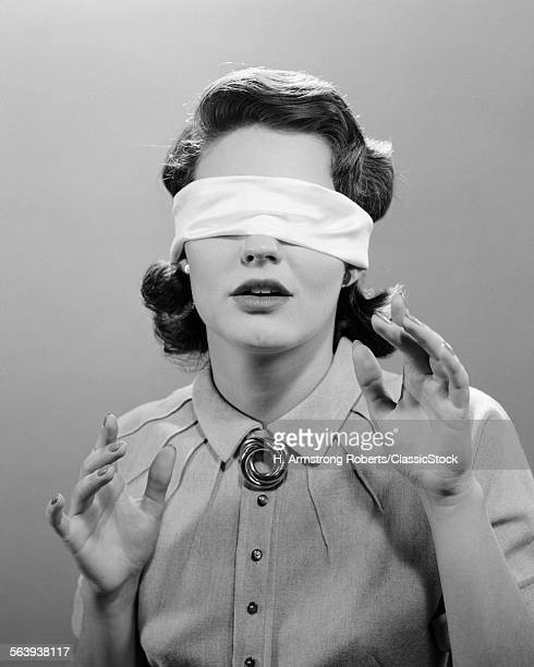 1950s WOMAN BLINDFOLDED
