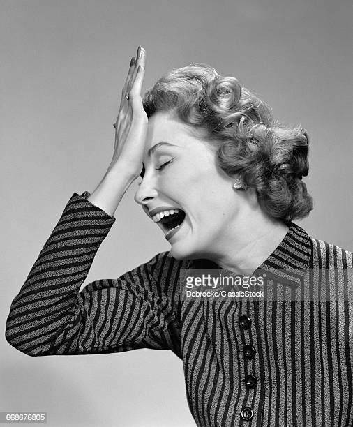 1950s WOMAN HITTING...