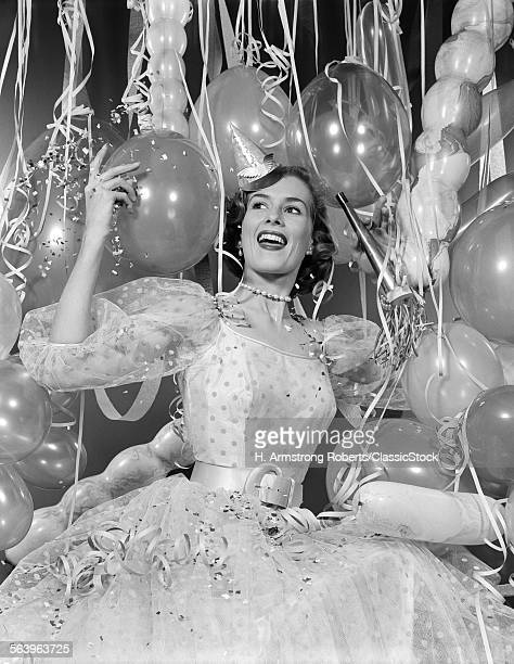 1950s WOMAN IN PARTY DRESS...
