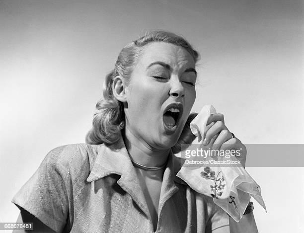1950s WOMAN SNEEZING...