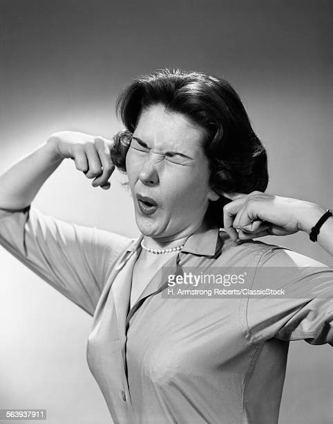 1950s WOMAN STICKING...