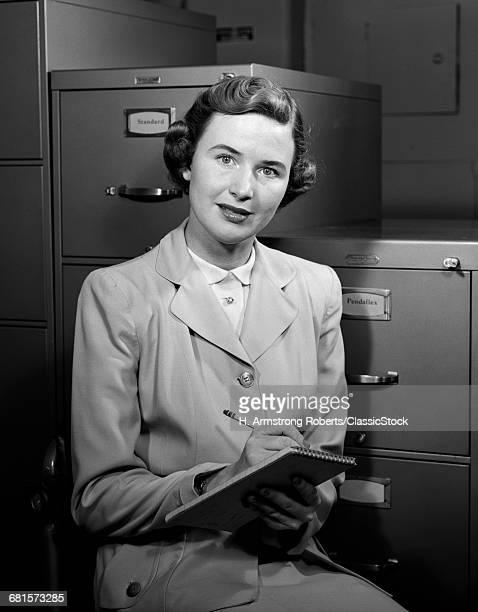 1950s WOMAN WRITING IN...