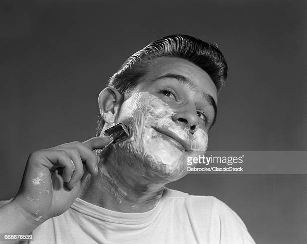 1950s YOUNG MAN SHAVING...