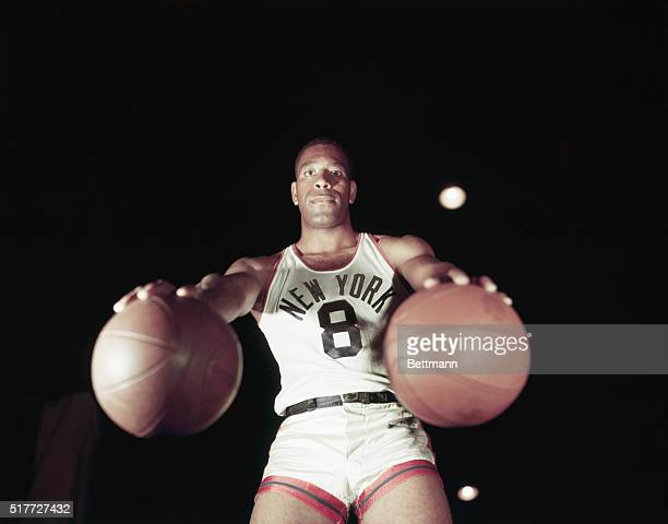 1951Nat Sweetwater Clifton of the New York Knickerbockers holding a basketball in each hand