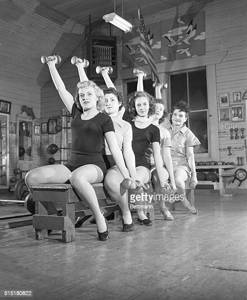 'If you don't watch your figure no one else will' is a sage bit of advice being heeded by pretty belles of Clem Folkman's 'Health Studio' in...