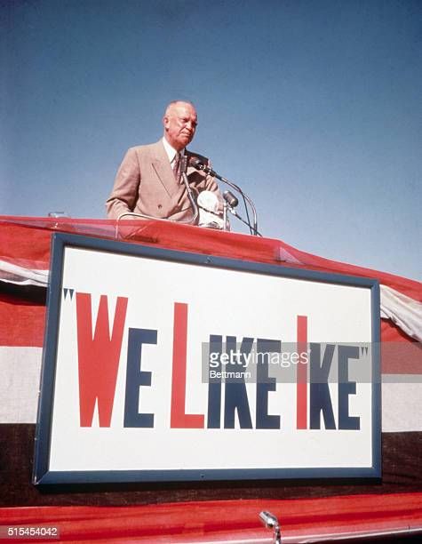 General Dwight D Eisenhower standing at the mike behind poster 'I Like Ike' during his campaign in Lubbock Texas BPA