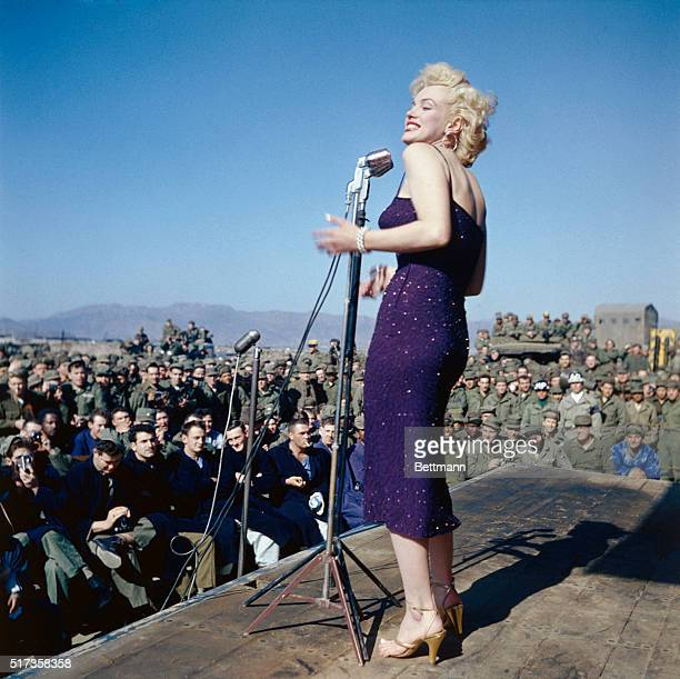 1954Marilyn Monroe entertaining US troops in South Korea She is showing her left profile in this full length photograph