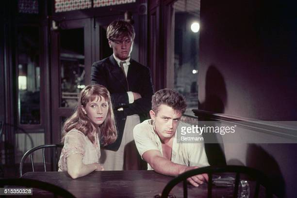 1955James Dean and Julie Harris sit together at a table while Dick Davalos stands above them in a scene from 1955 film 'East of Eden'