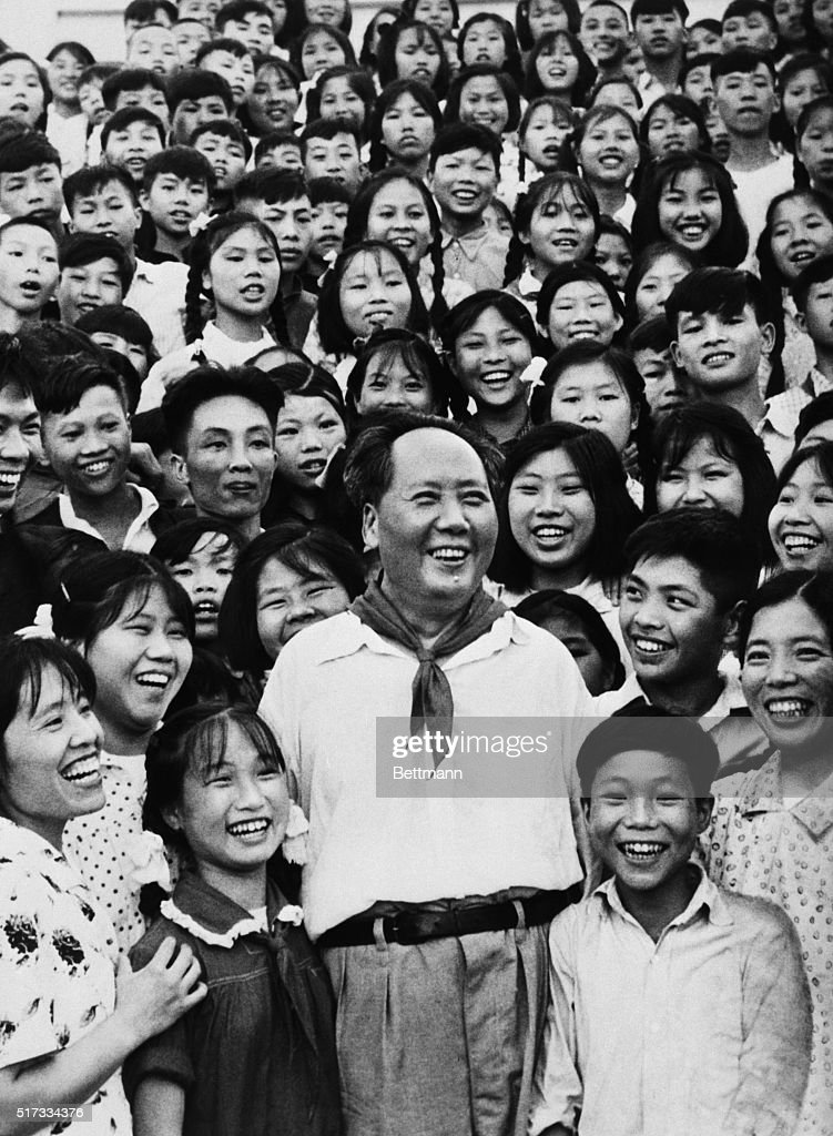 Smiling Chairman Mao Tse-Tung standing in the middle of teachers and students of the Shaoshan School in 1959. Filed 8/19/1976.