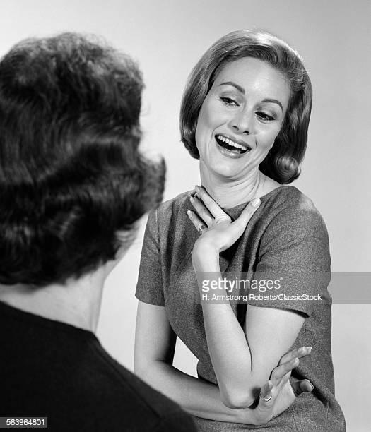 1960s 2 WOMEN TALKING ONE...